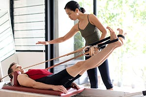 Teaching Pilates in studio